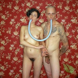 One nudist couple with cool tattoos