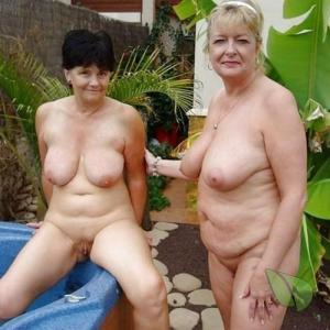 One nudists sitting at home outside