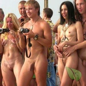 a couple nude people getting painted outdoors