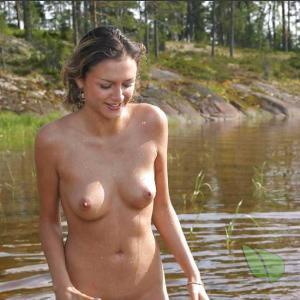 Solo girl splashing around in nature