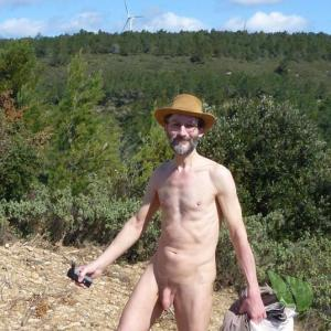 Solo nudist walking in nature