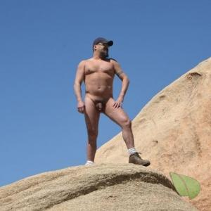 A nudist out hiking outdoors