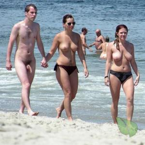 a crowd of nudists in the water