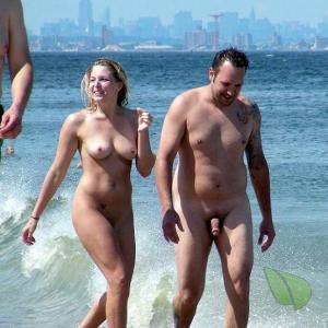 A nudist showing off their tats in the wilderness