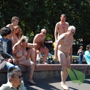 a crowd of nudey with cool tattoos in nature