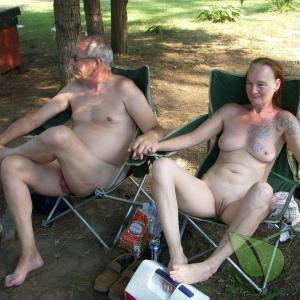 Solo naturist showing off their tats at the campground
