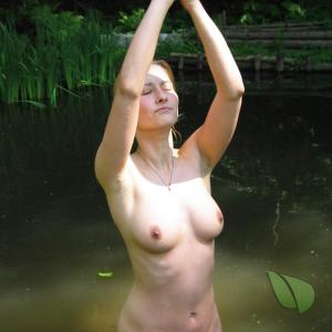 Solo nudists practicing asanas outdoors