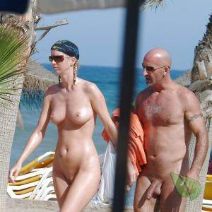 A nudist couple all tattooed up in the wilderness