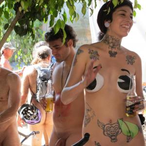 some nude people rocking tattoos