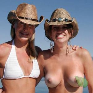 a couple women enjoying the water outdoors