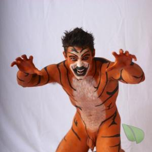 Solo male being bodypainted