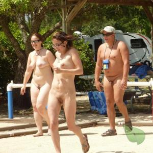 a crowd of nudist rocking tattoos at the campground