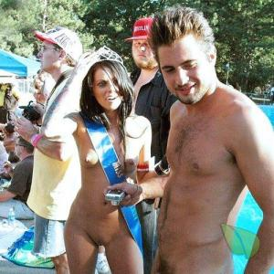 Solo nudist couple all dressed up outside