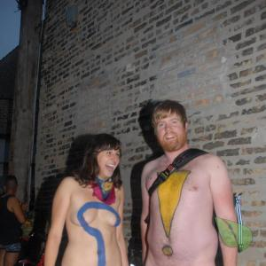 Solo nudist couple wearing fun bodypaint in the wilderness