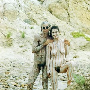 A naturist rocking bodypaint outdoors