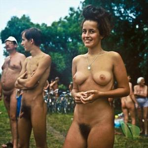 a crowd of nude person in the wilderness
