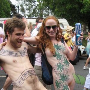 A naturist rocking tattoos outdoors