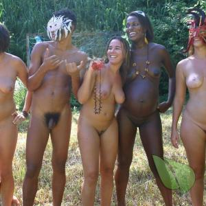 a crowd of naturist in a costume out and about