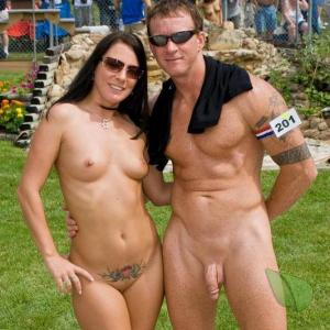 Solo nudist couple with cool tattoos in the woods