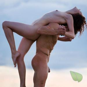 Solo nudist practicing asanas in the wilderness