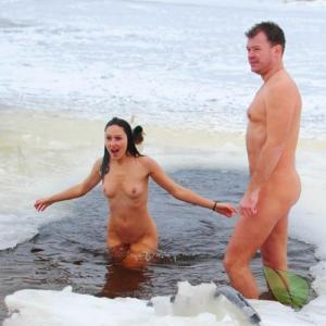 One nude person relaxing in the water out and about