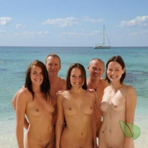 a group of co-ed nudists in nature