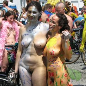a couple girls covered in bodypaint outside
