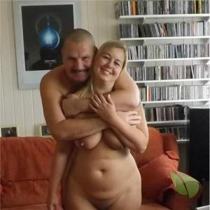 One nude person having fun at home