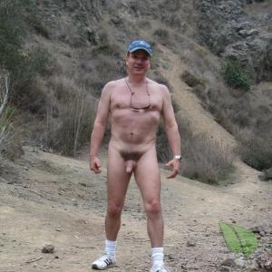 A nudist walking outside