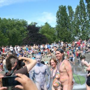 a couple nudists covered in bodypaint in the wilderness