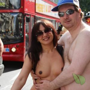 One nude couple outside