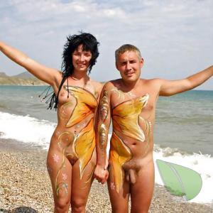 One nudist wearing fun bodypaint outside