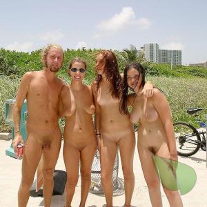 a crowd of co-ed nudists outside