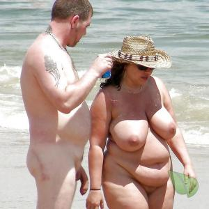 A nudist couple showing off their tats out and about