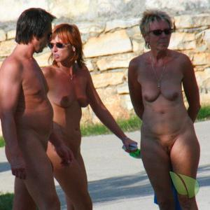 a crowd of nudist in the forest