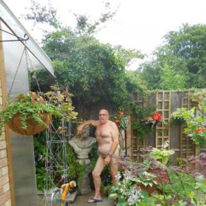 A man posing in their house in nature