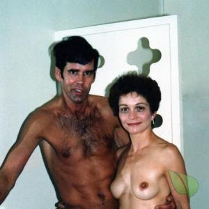 Solo nudist posing in their house