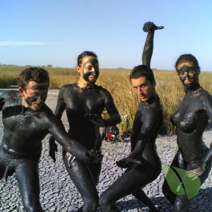 a crowd of nude person wearing a fun costume in nature