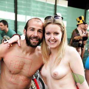 A nudist being bodypainted out and about