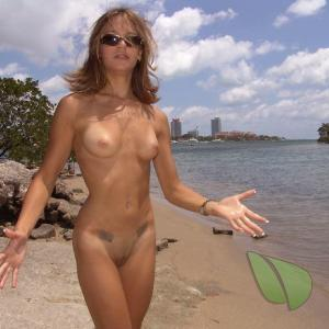 One nudists showing off their tats outdoors