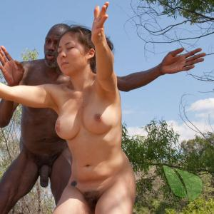 Solo nudist couple doing yoga poses in the wilderness