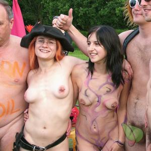 a group of nudists wearing a fun costume in the woods