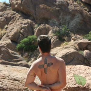 Solo dude with cool tattoos in the wilderness