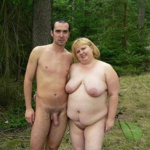 A nude couple outside