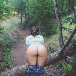 One girl walking in the wilderness
