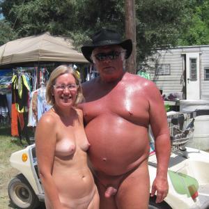One nudist couple outside