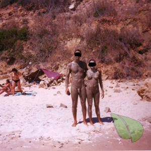 One nudist couple outdoors