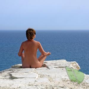 One woman doing yoga poses outside