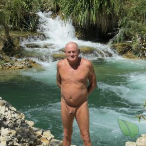 A guy having fun in the water in the wilderness