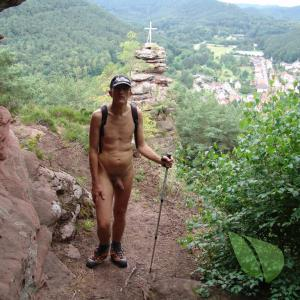 A nudist trekking in nature
